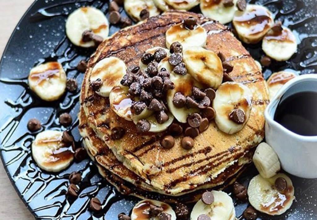 pancakes with chocolate, banana and syrup