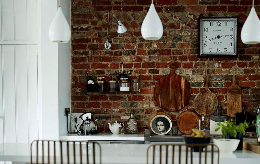 kitchen with a brick wall and kitchen items on display.