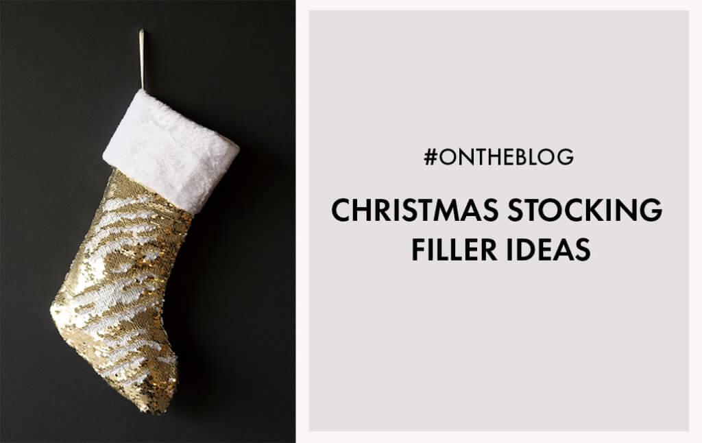 Lifestyle image of a gold glitter stocking.