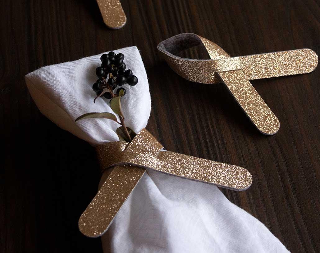 Gold glitter napkin or cutlery ring holder loop crosses
