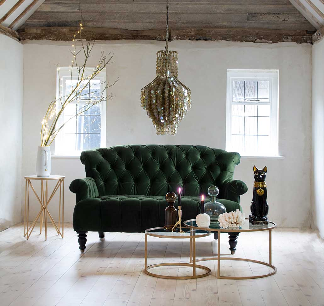 Green velvet sofa with gold chandelier Christmas home design ideas