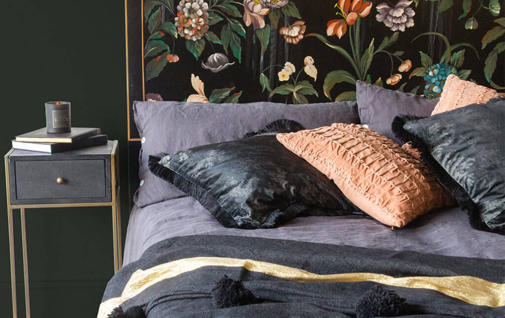 linen bedding with soft throws and velvet cushions on the bed