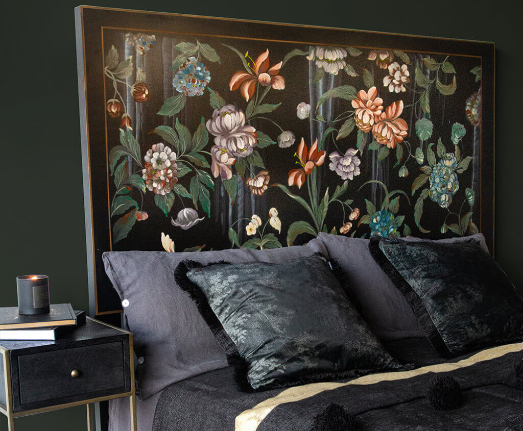 lifestyle image of floral headboard on dark green background