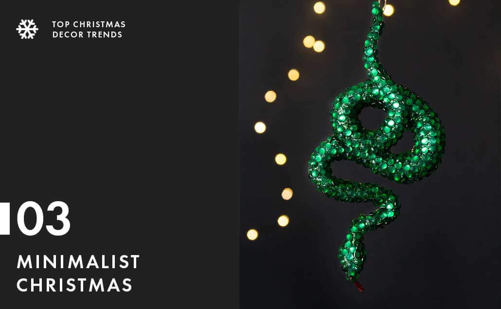 Lifestyle image of green snake christmas tree decoration.