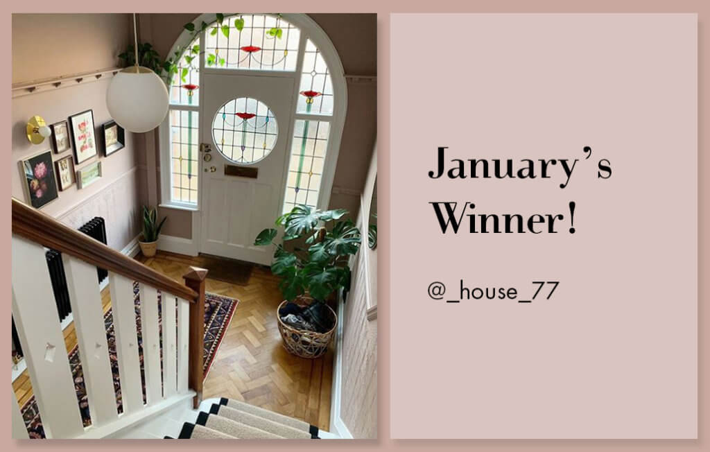 pink hallway with original 1920s doors and art deco ceiling light