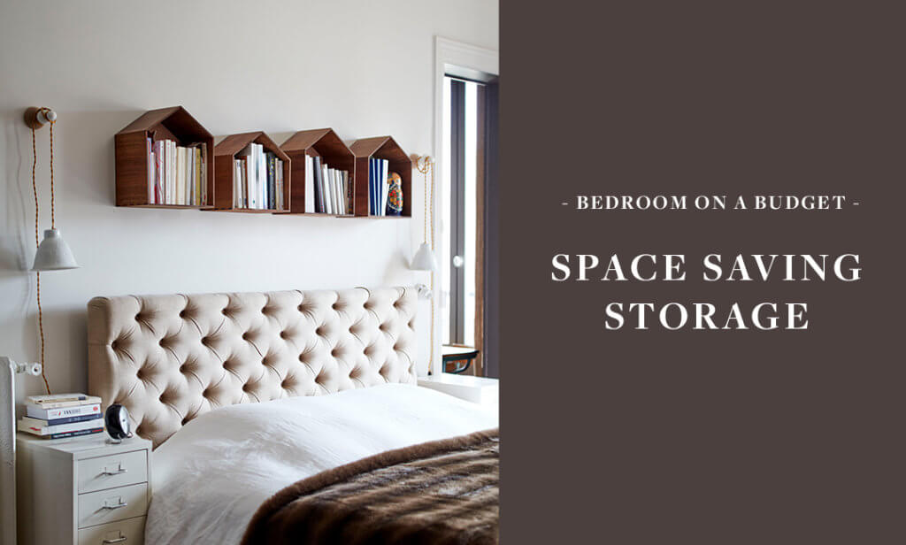 bedroom with wooden house shelves above the bed filled with books