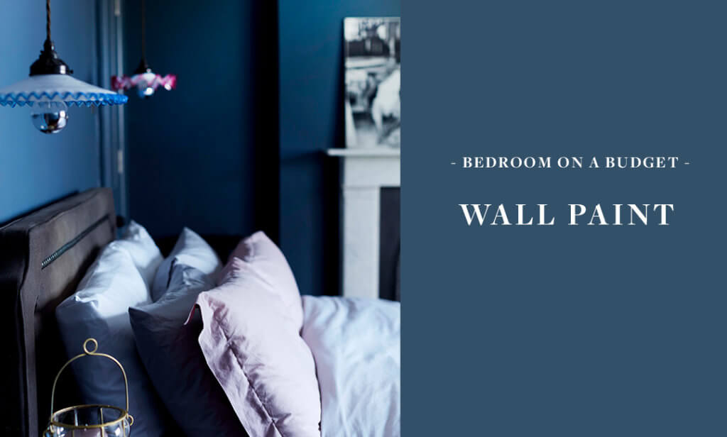 blue bedroom with pink bedding and hanging ceiling lights