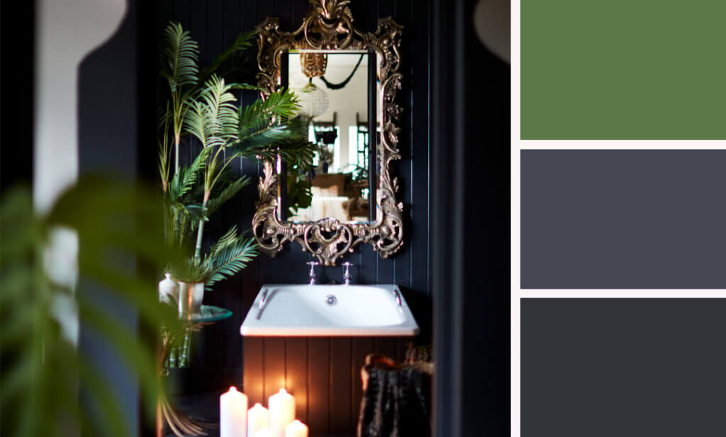 dark bathroom with candlelight and large gold ornate mirror
