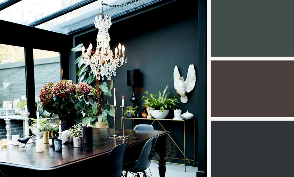 dark dining room with a dazzling chandelier hanging over the dining table.