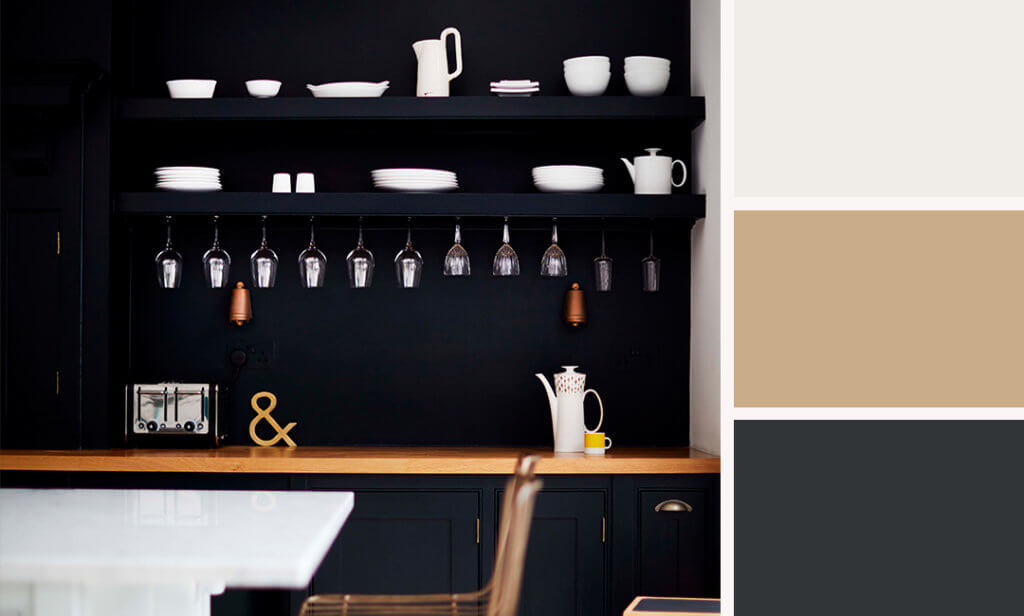 dark kitchen with white surfaces and crockery.
